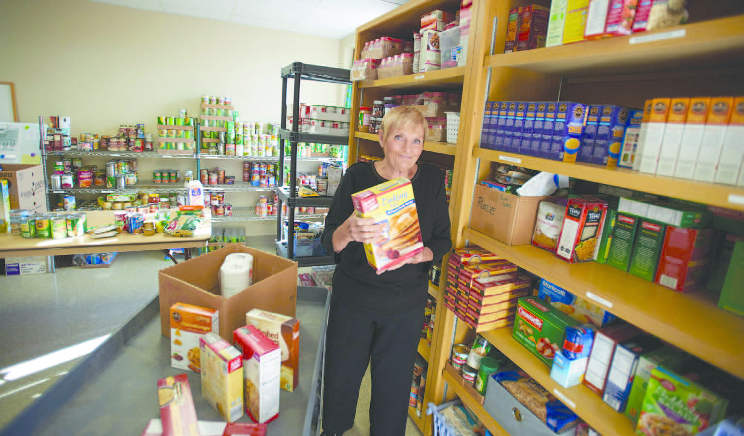 Marcy feeds the hungry from the mobile pantry catholic for Roman pantry