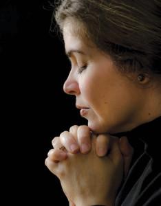 Hispanic woman praying to his saviour in heaven The Power of Prayer