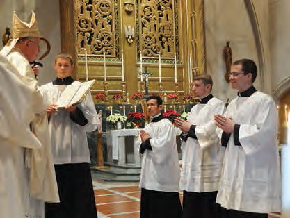 Luther Diazbanuelos (from left), Daniel Williams, and Levi Schmitt are received as Candidates for Orders by Bishop Callahan on Dec. 30, 2015.