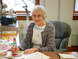 Sister Rita Schmidt is painting using water colors in her art studio at the Motherhouse.
