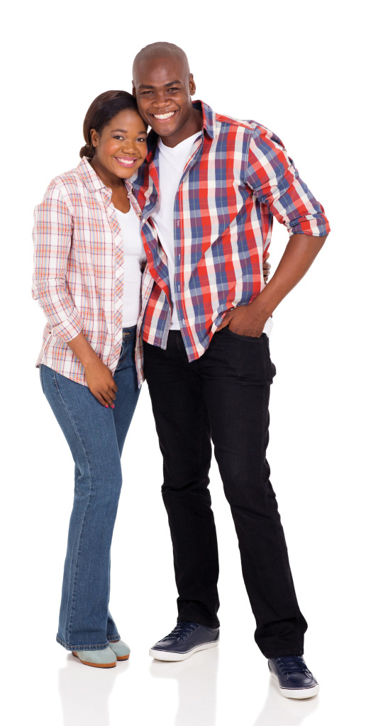 portrait of happy young afro american couple posing on white background