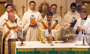 Father Sedlacek celebrates his first Mass at Holy Cross Church, his home parish in Cornell, the day after his ordination.