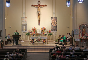 Father Kevin Louis, native son of Sacred Heart Parish, shares parish memories with the congregation. (Sharon Sliwka)