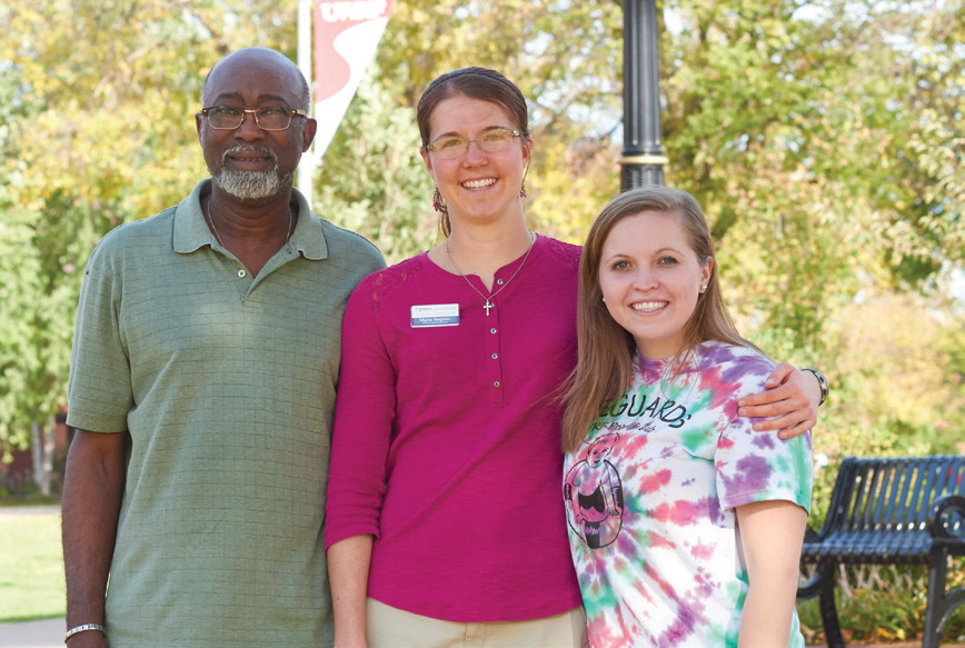 Lifeguard's Academic advisor Jerry Liddell (left), Marie, and current Lifeguard's secretary Kelly Bodra, gather on the UW- River Falls campus where the group began.