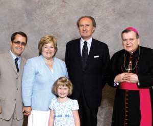 Emily Strom is pictured with her parents, Tom and Amy, Cardinal Burke and St. Gianna's son Pierluigi in 2009.