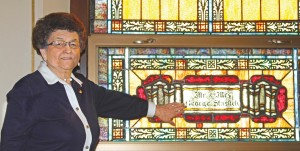 Catherine Warnecke stands next to a stained-glass window at St. Wenceslaus Church in Milladore. The church was built in 1883 by Bohemian immigrants.