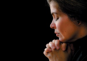 Hispanic woman praying to his saviour in heaven The Power of Prayer